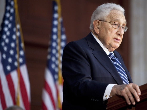 Former U.S. secretary of state Henry Kissinger delivers a speech in front of a picture of late U.S. president Richard Nixon meeting with late premier Zhou Enlai during a ceremony in Shanghai to commemorate the 30th anniversary of the