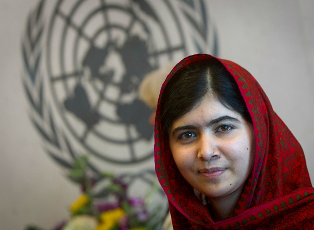 Pakistani schoolgirl activist Malala Yousafzai poses for pictures at the United Nations in New York, New York, August 2014 (Courtesy Reuters/Carlo Allegri).