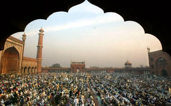 Indian Muslims wait for morning Eid prayer at the Jama Masjid in New Delhi (Pawel Kopczynski/Courtesy Reuters).