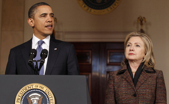 President Barack Obama speaks about Libya as Secretary of State Hillary Clinton listens in the White House in Washington