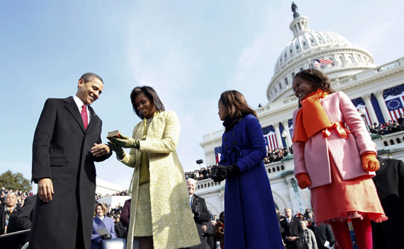 U.S. President Barack Obama and his wife Michelle examine the bible used for his swearing-in ceremony in Washington
