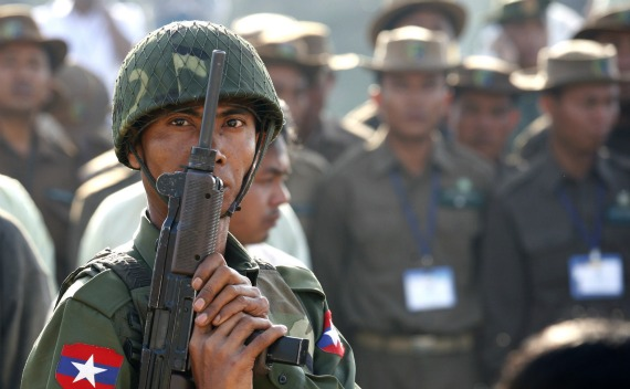 A soldier holds a gun during an opening ceremony of the Safari garden in the new capital Naypyitaw on February 12, 2011.