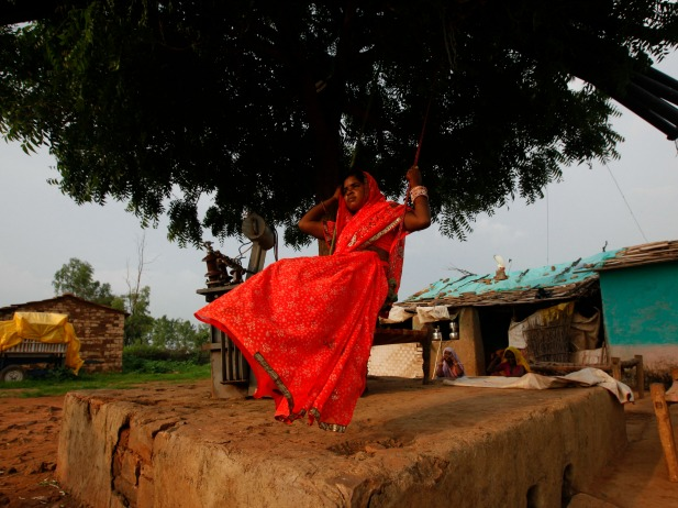 Child bride Krishna, 12, plays on an improvised swing outside her house in a village near Baran, India, July 2011 (Courtesy Reuters/Danish Siddiqui).