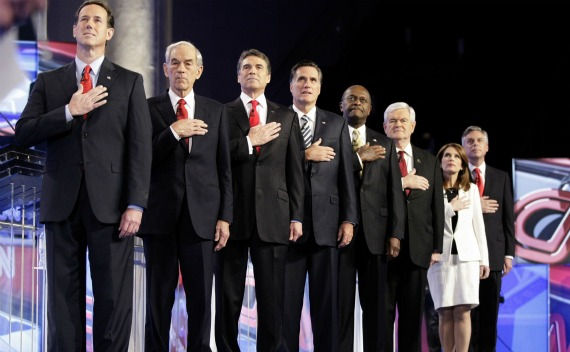 Republican presidential candidates stand at attentiond during the singing of the national anthem during the CNN GOP National Security debate on November 22, 2011.