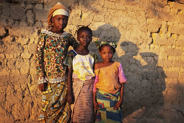 Mariam Jallo, 11, (L), who wants to become an office worker, Bintu Kamara, 6, (C) who would like to become a lawyer, and Binta Jallo, 5, who wants to become a businesswoman, pose for a portrait in Koidu, eastern Sierra Leone, April 21, 2012. REUTERS/Finbarr O'Reilly