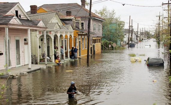 A man walks through the flooded Terme area of New Orleans, lying under several feet of water on August 29, 2005.