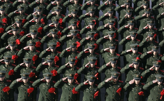 Chinese policemen salute during a ceremony in Shanxi province.