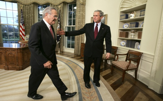 US President Bush escorts Secretary of Defense Rumsfeld from the Oval Office in Washington on August 11, 2006 (Courtesy Reuters/Kevin Lamarque).