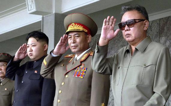 Kim Jong-il and Kim Jong-un salute during a military parade (courtesy Reuters/KCNA)