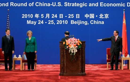 China's Vice Premier Wang Qishan gestures to U.S. Treasury Secretary Timothy Geithner and U.S. Secretary of State Hillary Clinton during the opening ceremony of the China-U.S. Strategic and Economic Dialogue in Beijing