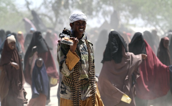 An al-Shabaab soldier carries his gun in southern Mogadishu on January 1, 2011 (Feisal Omar/Courtesy Reuters).