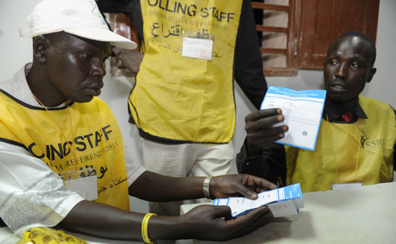 Polling center workers sort and count ballots in Aweil, Sudan.