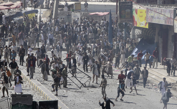 Government backers hurl rocks at anti-government protesters during clashes in Sanaa February 17, 2011. Hundreds of Yemen government loyalists wielding batons and daggers chased off a small group of protesters trying to kick off a seventh day of rallies on Thursday to demand their president end his thirty-two year rule. (Ammar Awad/ courtesy Reuters)
