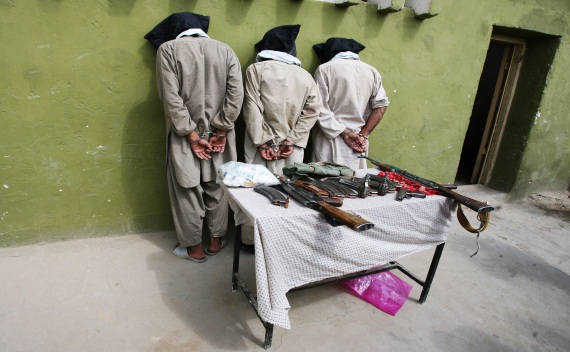 Three captured Taliban insurgents are presented to the media in Ghazni province on August 25, 2011 (Mustafa Andaleb/Courtesy Reuters).