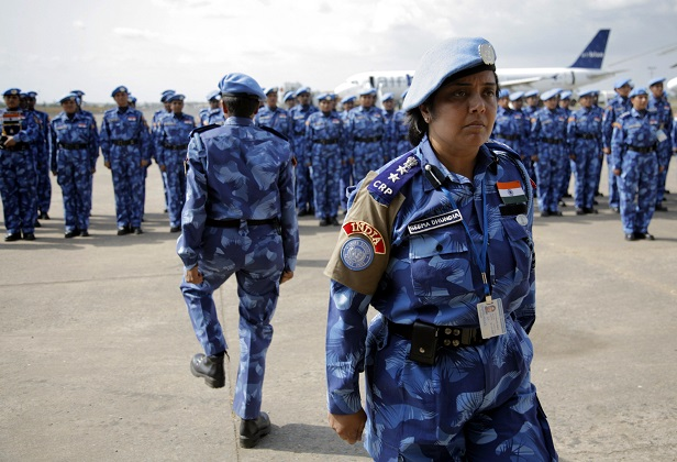The first all-female unit of UN peacekeepers stand at attention as they arrive at Roberts International Airport outside Liberia's capital Monrovia January 30, 2007. The group of more than 100 police women from India will stay in Liberia for six months, helping to train the local police force. REUTERS/Christopher Herwig (LIBERIA) - RTR1LTD2