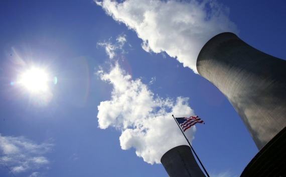 US Flag in Front of Cooling Towers