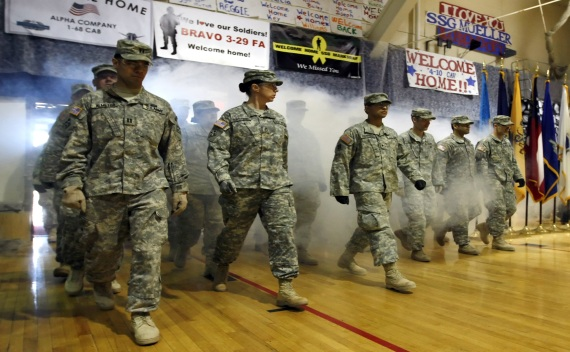 U.S. Army soldiers returning from duty in Iraq walk through smoke as they arrive during a welcome home ceremony in Colorado Springs on February 13, 2009 (Rick Wilking/Courtesy Reuters).