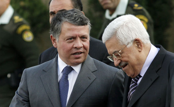 King Abdullah of Jordan (L) speaks with Palestinian President Mahmoud Abbas during a welcoming ceremony in the West Bank city of Ramallah November 21, 2011. Abdullah arrived in Ramallah on Monday for a rare visit to the Israeli-occupied West Bank, as the Palestinians pursue statehood in a region riveted by the slide towards civil war in Syria and mounting unrest in Egypt (Mohamad Torokman/Courtesy Reuters).
