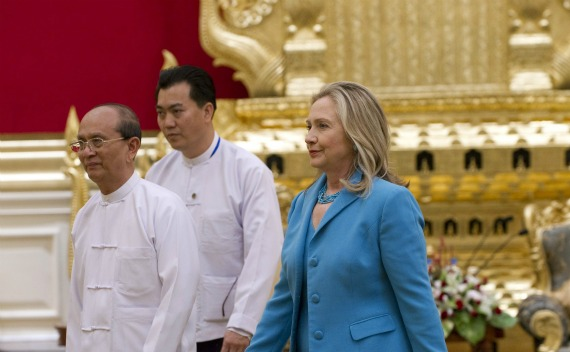 U.S. Secretary of State Hillary Clinton walks with Myanmar's President Thein Sein at the President's Office in Naypyitaw on December 1, 2011.