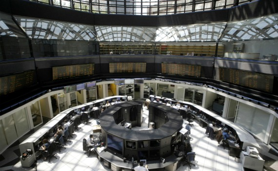 Mexico's stock exchange employees work at their desks in Mexico City (Henry Romero/Courtesy Reuters).