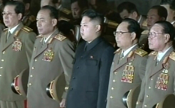 North Korean Leader Kim Jong-un and military officer Jang Song-taek paying their respects (Courtesy: Reuters)