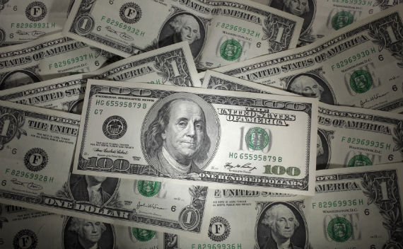A picture illustration shows a 100 Dollar banknote laying one Dollar banknotes.