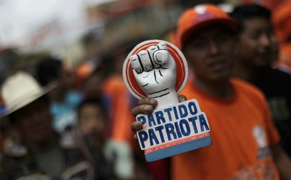A man holds a symbol of the Patriot Party during a political rally in Solola (Jorge Lopez/Courtesy Reuters).