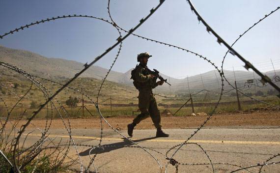 An Israeli soldier patrols along the Israeli-Syrian border near Majdal Shams in the Golan Heights (Ronen Zvulun/Courtesy Reuters)