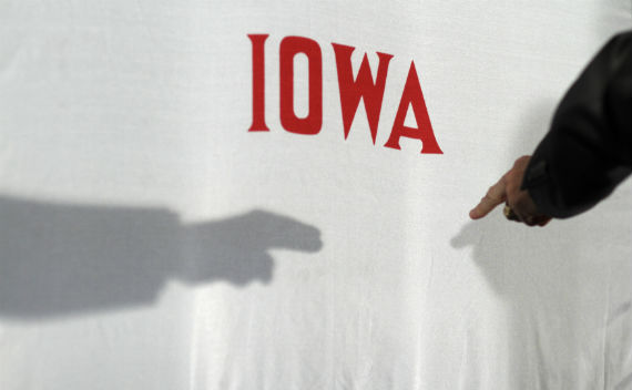 Governor Rick Perry points at the Iowa state flag during a campaign event in December, 2011 (John Gress/courtesy Reuters).