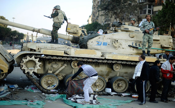 Egyptian soldiers chat as they stand on their tank before moving to another location at Tahrir Square in Cairo on February 12, 2011 (Dylan Martinez/Courtesy Reuters)