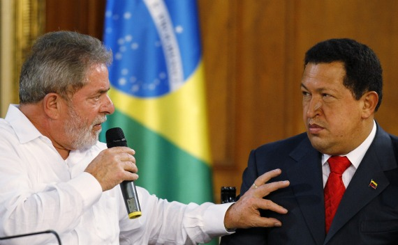 Venezuelan President Chavez looks on as his Brazilian counterpart Lula da Silva speaks during their meeting at Miraflores Palace in Caracas