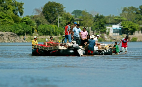 Undocumented Migrants travel on raft bound for Ciudad Hidalgo, Mexico