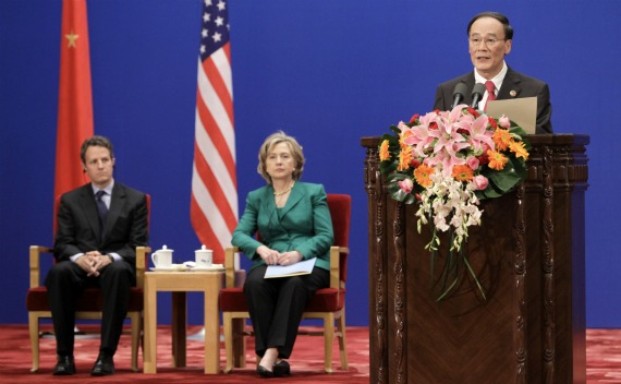 China's Vice Premier Wang Qishan delivers a speech as U.S. Secretary of State Hillary Clinton and U.S. Treasury Secretary Timothy Geithner sit behind during the opening ceremony of the U.S.-China Strategic Economic Dialogue in Beijing in 2010.