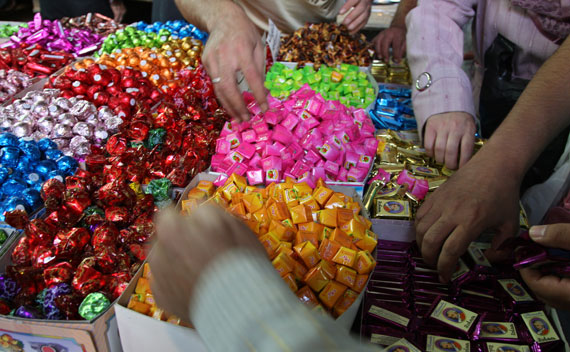 People buy sweets at Souk al-Hamidieh in Damascus' old downtown (Khaled Al Hariri/Courtesy Reuters)