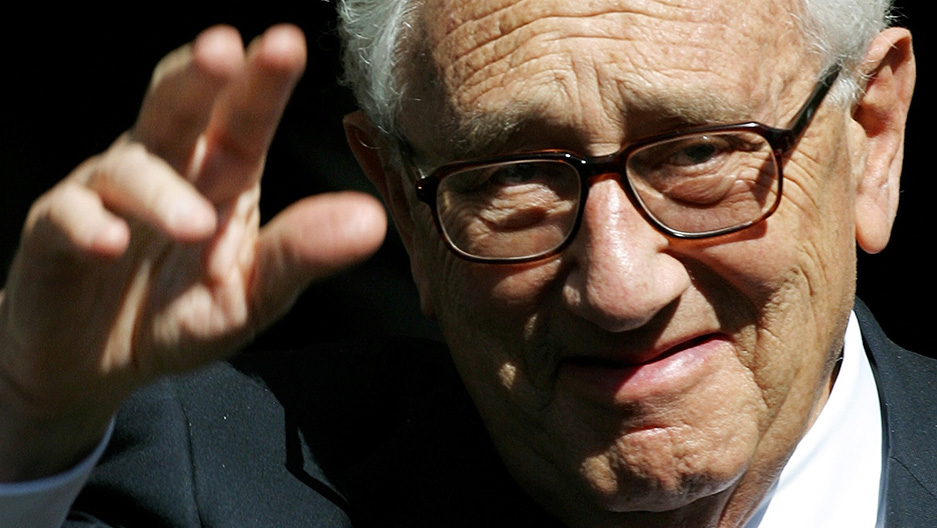 Henry A. Kissinger waves