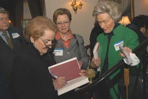Secretary Albright signing books.