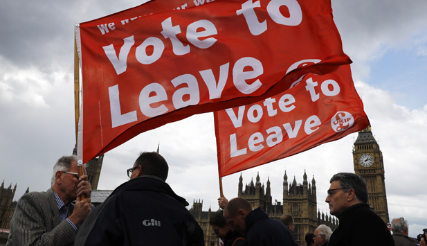 Leave campaigners wave banners in front of Parliament