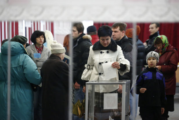 A woman casts her ballot at a polling station in Simferopol on March 16, 2014