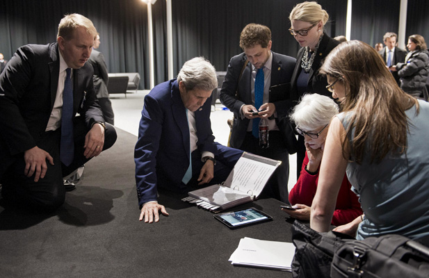 U.S. Secretary of State John Kerry (2nd L), U.S. Under Secretary for Political Affairs Wendy Sherman (2nd R) and staff watch a tablet in Lausanne as U.S. President Barack Obama makes a state address on the status of the Iran nuclear program talks, April 2, 2015.