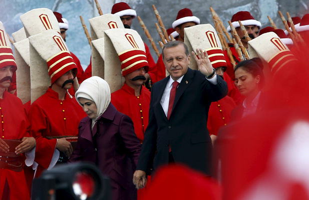 Turkish President Tayyip Erdogan, accompanied by his wife Emine Erdogan (L), greets his supporters as he arrives at the a ceremony to mark the 562nd anniversary of the conquest of the city by the Ottoman Turks, in Istanbul, Turkey, May 30, 2015.