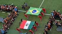 Flag bearers carry the Mexican and Brazilian flags out onto the pitch prior to the 2014 FIFA World Cup Brazil Group A match between Brazil and Mexico at Castelao on June 17, 2014 in Fortaleza, Brazil.