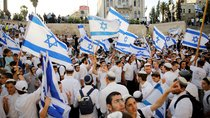 "Jewish youth wave Israeli flags as they participate in a march marking ""Jerusalem Day"", near Damascus Gate in Jerusalem's Old City June 2, 2019."