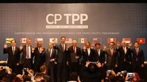 Representatives of members of Trans-Pacific Partnership (TPP) trade deal wave as they pose for an official picture after the signing agreement ceremony in Santiago, Chile March 8, 2018.