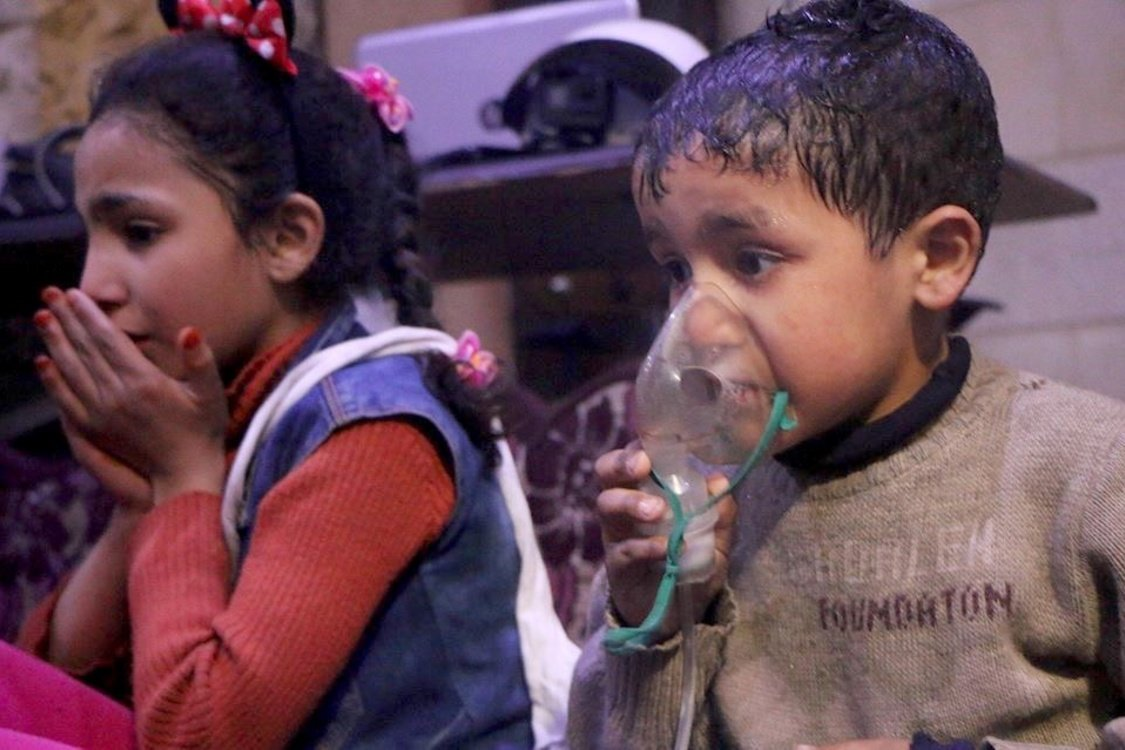 Syrian children receive medical attention after a chemical attack in Eastern Ghouta
