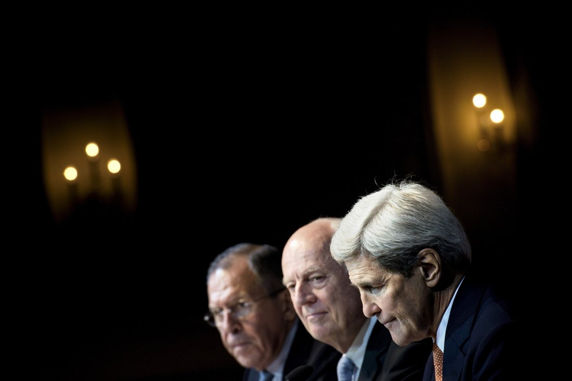 Russian Foreign Minister Sergei Lavrov, UN Special Envoy Staffan de Mistura, and U.S. Secretary of State John Kerry hold a news conference in Vienna.