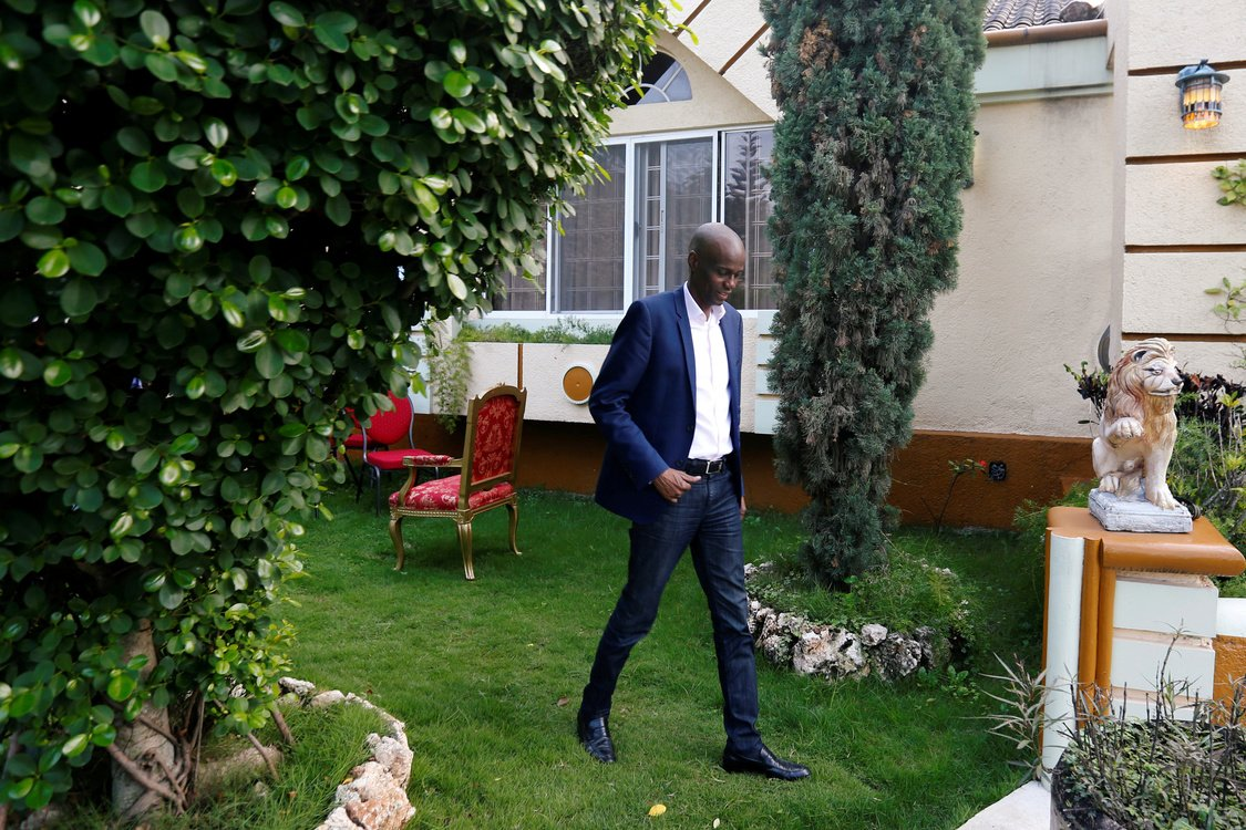 Haiti's President Jovenel Moise walks in the garden of his home