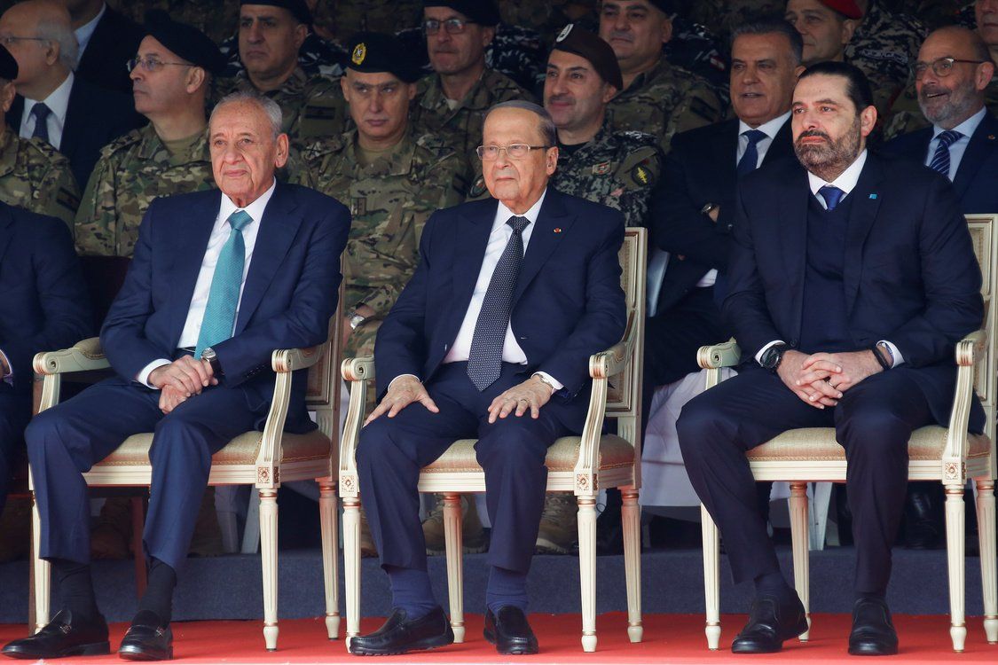 Lebanese Speaker of the Parliament Nabih Berri, Lebanon's President Michel Aoun and caretaker Prime Minister Saad al-Hariri attend a military parade