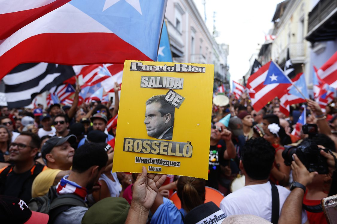 People celebrate the resignation of Puerto Rico Governor Ricardo Rossello