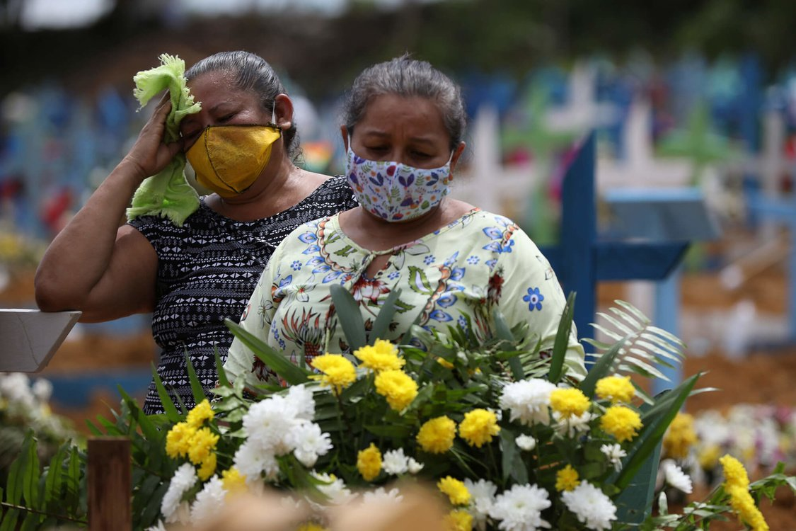 Women react during a collective burial of people that have passed away due to the coronavirus disease (COVID-19), at the Parque Taruma cemetery in Manaus, Brazil This