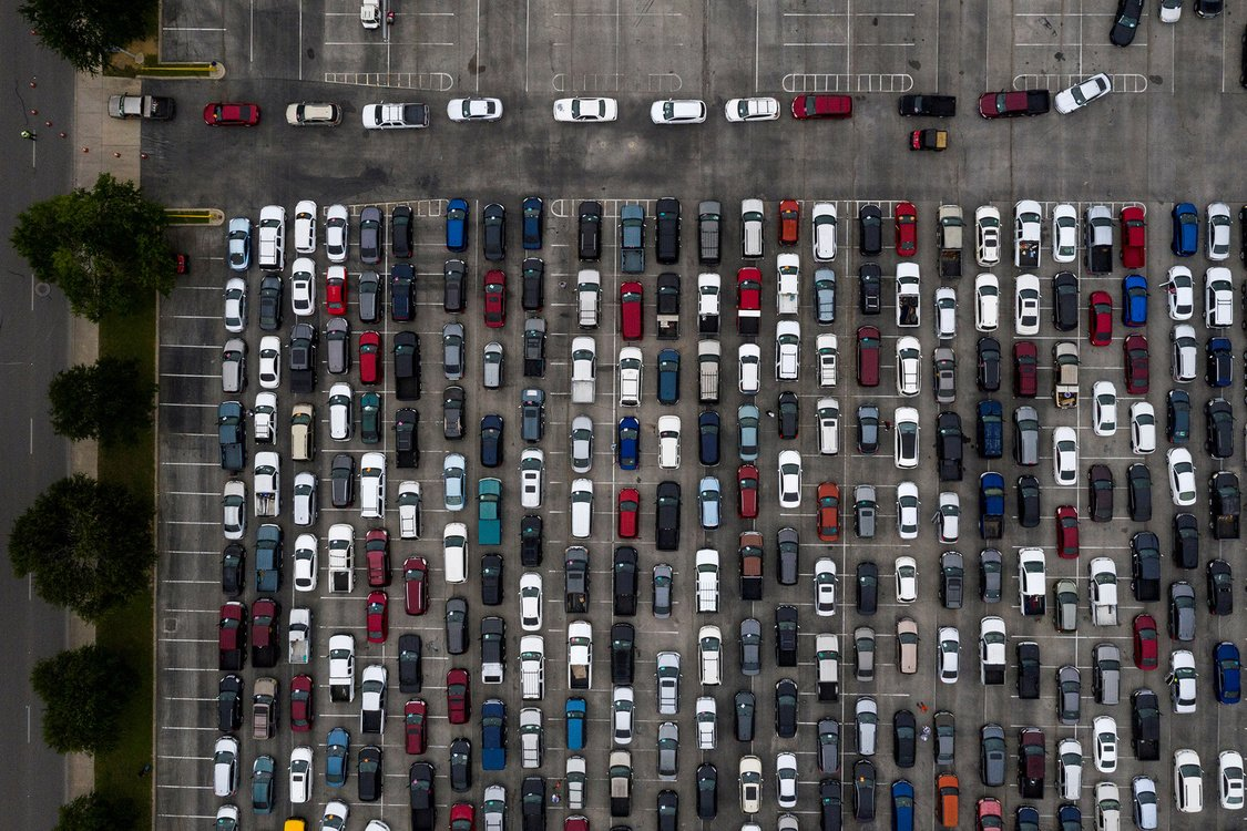 Aerial view of hundreds of residents lining-up in their vehicles as they await their turn to collect groceries from the San Antonio Food Bank.